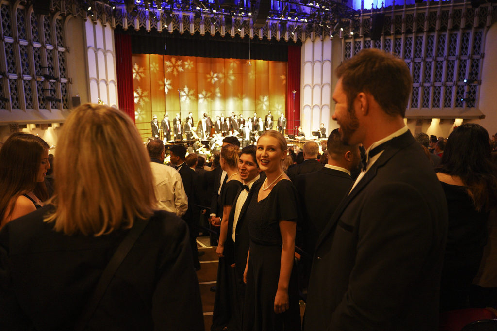 Choral singers in the aisles singing carols with the audience