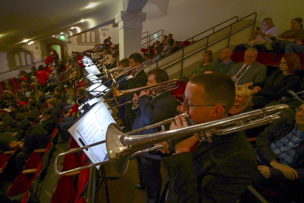 The USC Thornton Trombone Choir performing before the concert begins