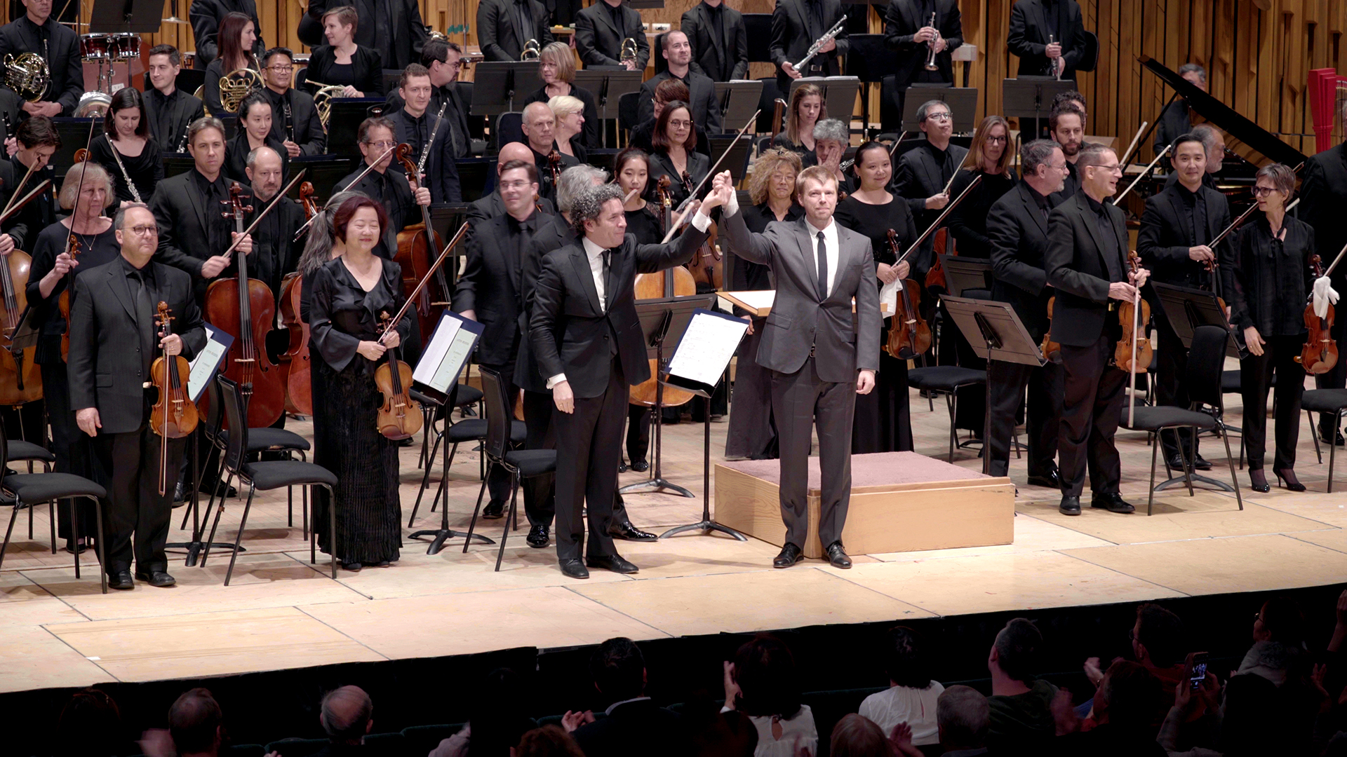Photo of Andrew Norman on stage with Gustavo Dudamel and LA Phil