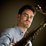 Photo of Daniel Weidlein holding saxophone