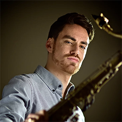 Photo of Daniel Weidlein holding saxophone
