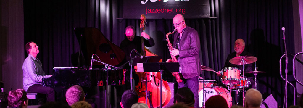 Photo of jazz faculty members playing on stage