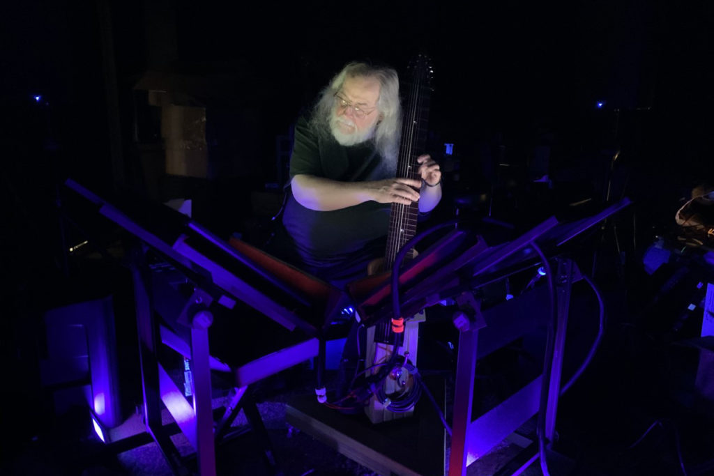 Photo of Bill Biersach performing on electronic music equipment