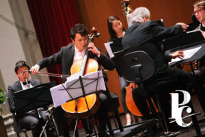 Photo of cellist Li-Wei Qin performing on stage