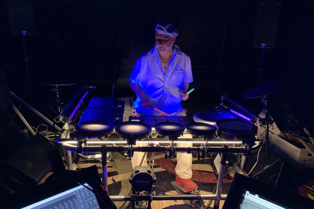 Photo of Ralph Loynachan performing on electronic music equipment