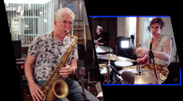 Photo of Bob Mintzer on saxophone and Louis Cole on drums