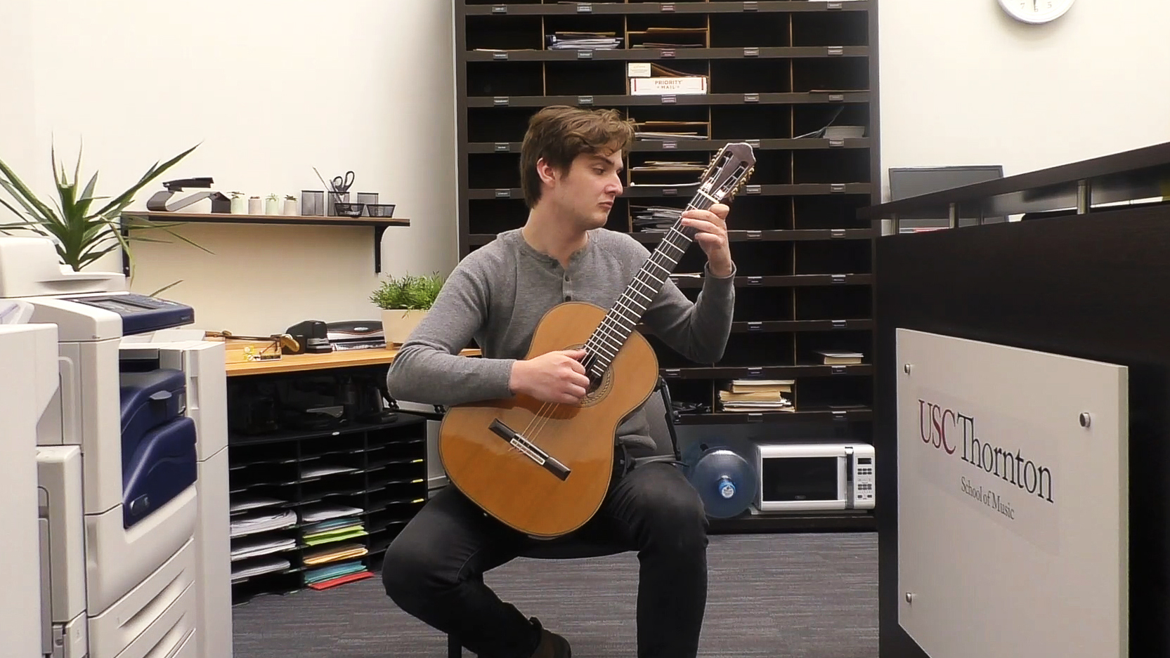 Nolan Juaire playing guitar