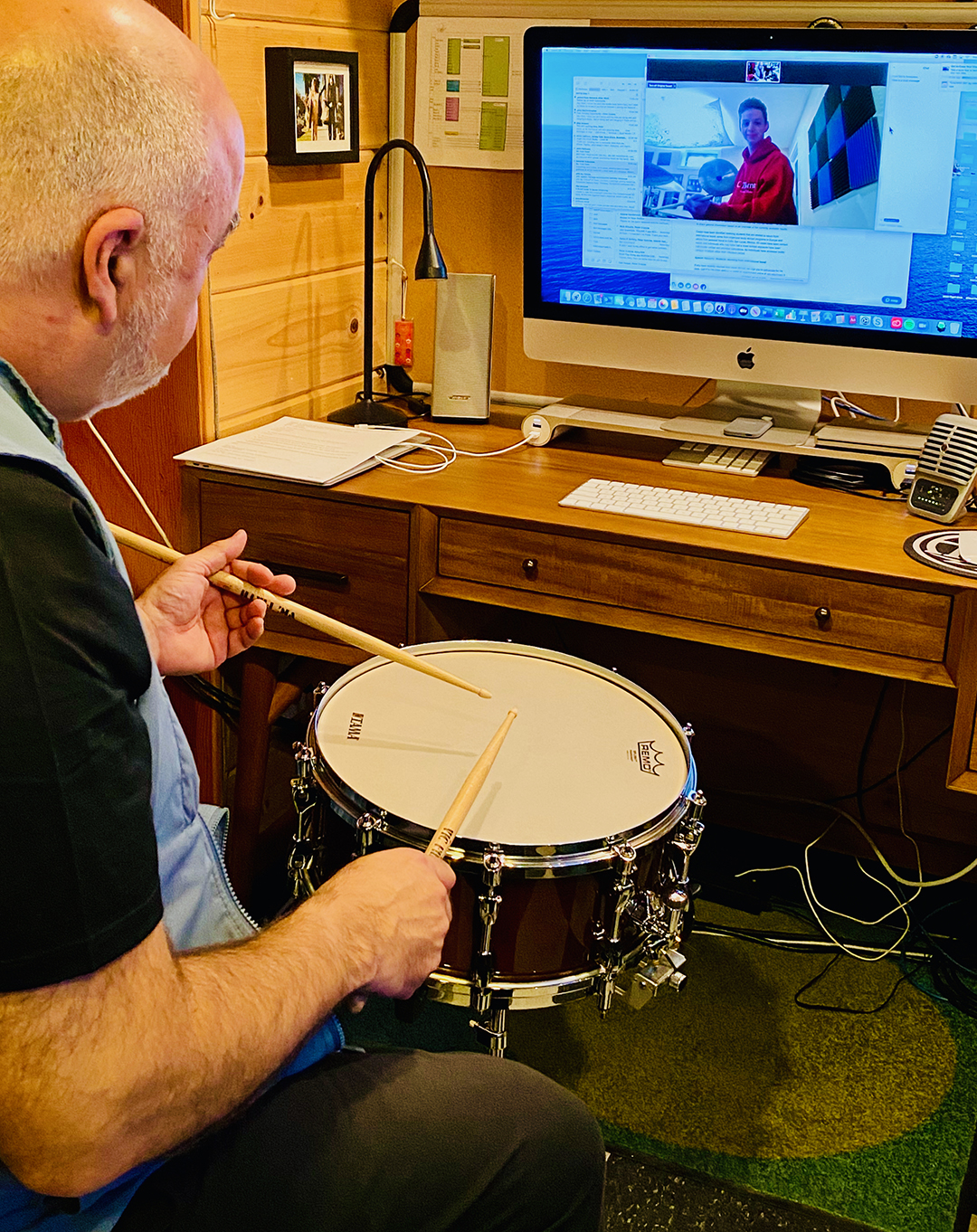 Peter Erskine instructs a drum student over a video call