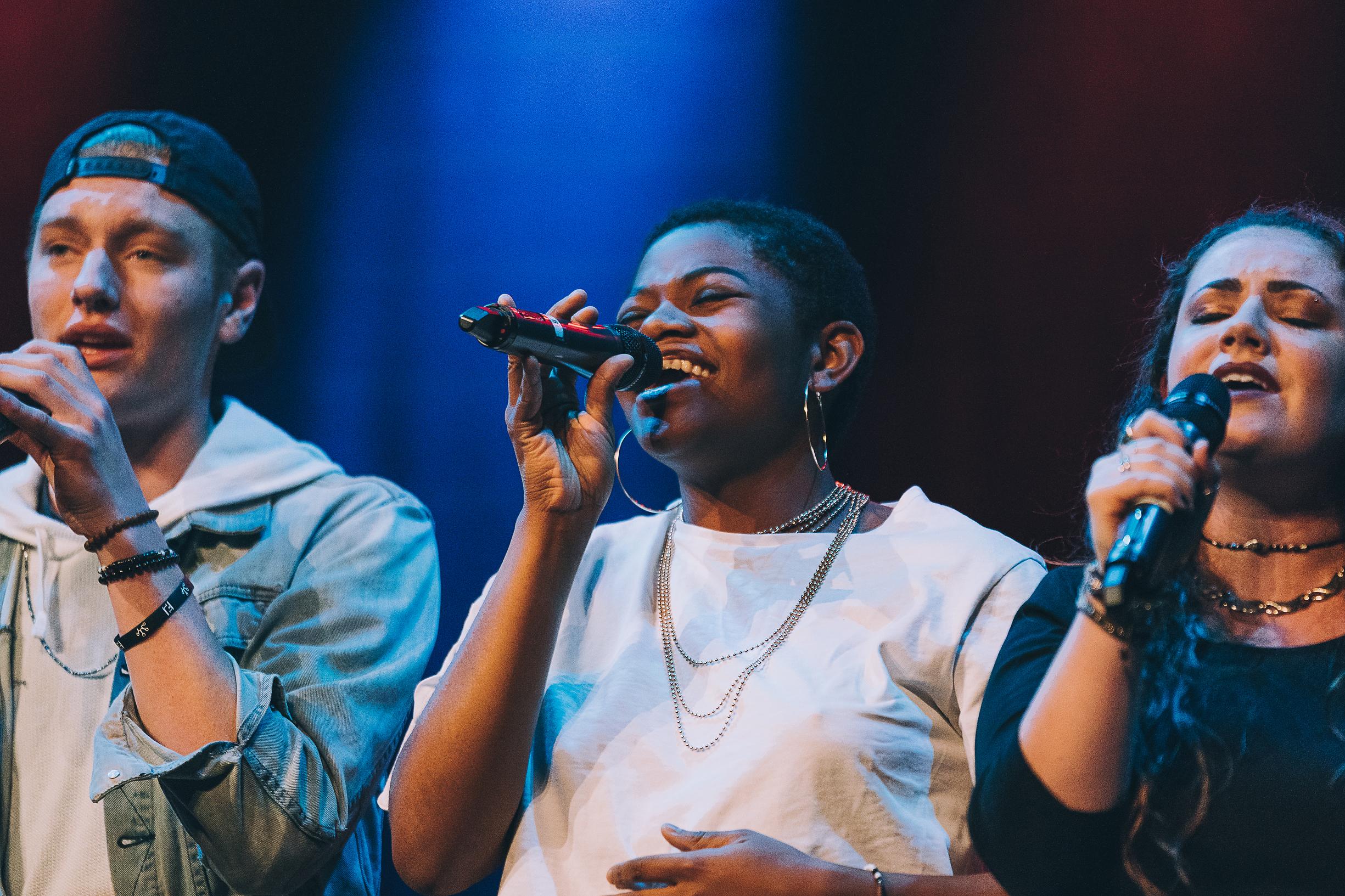 Tehillah Alphonso singing on stage