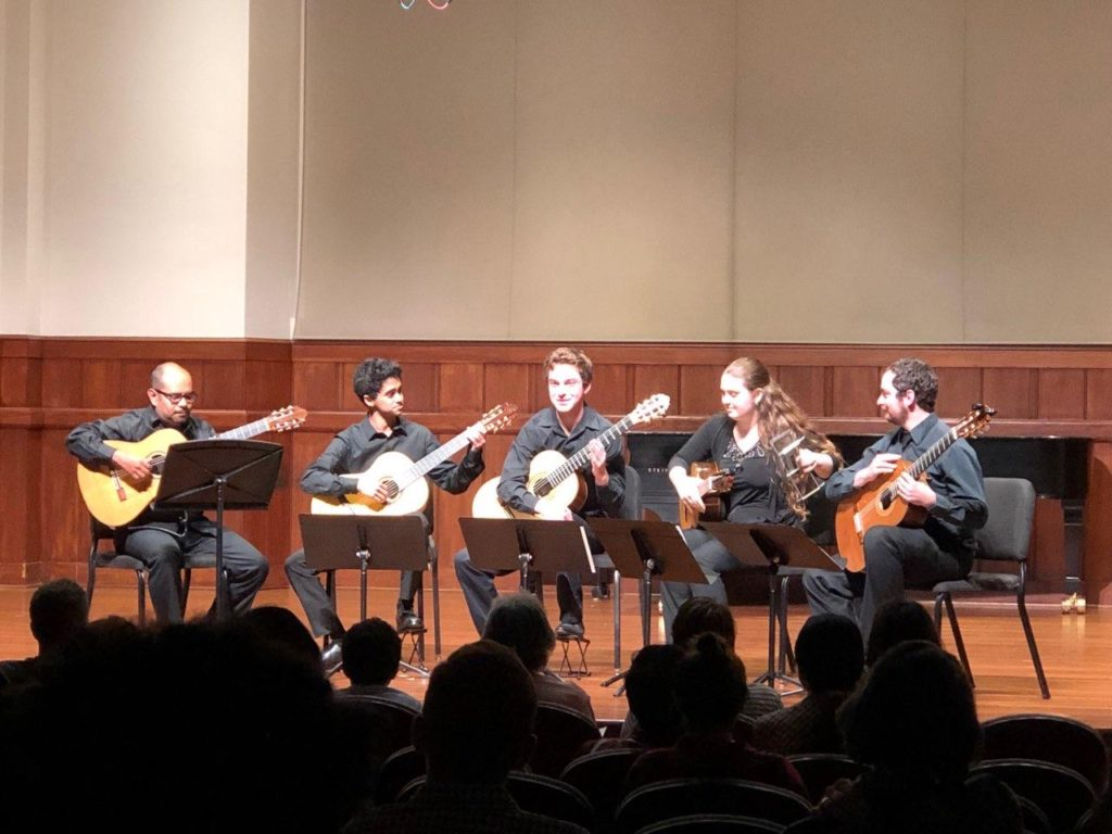 Music Teaching & Learning graduate Julio Sequeira (MM '20) performs with a non-major classical guitar quintet