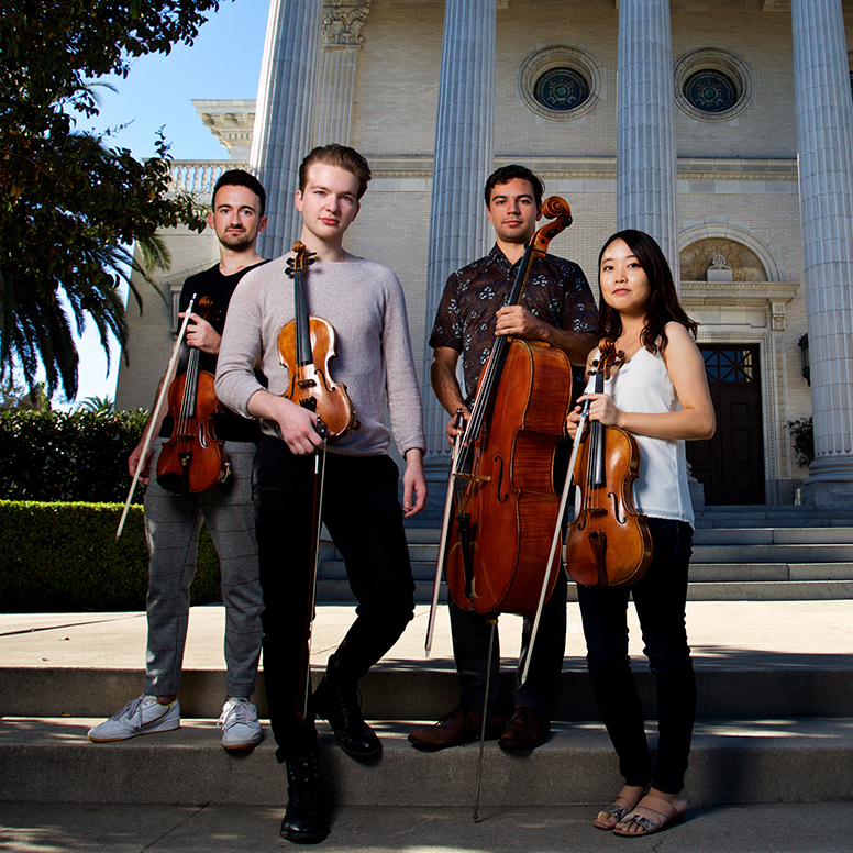 group of strings musicians outdoors with instruments