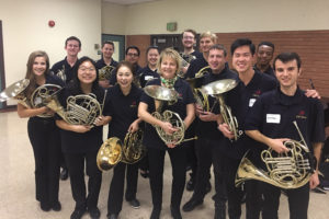 Kristy Morrell with horn students in concert black