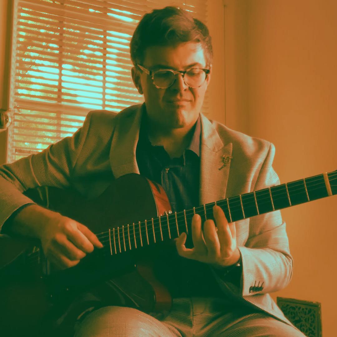 John storie playing guitar