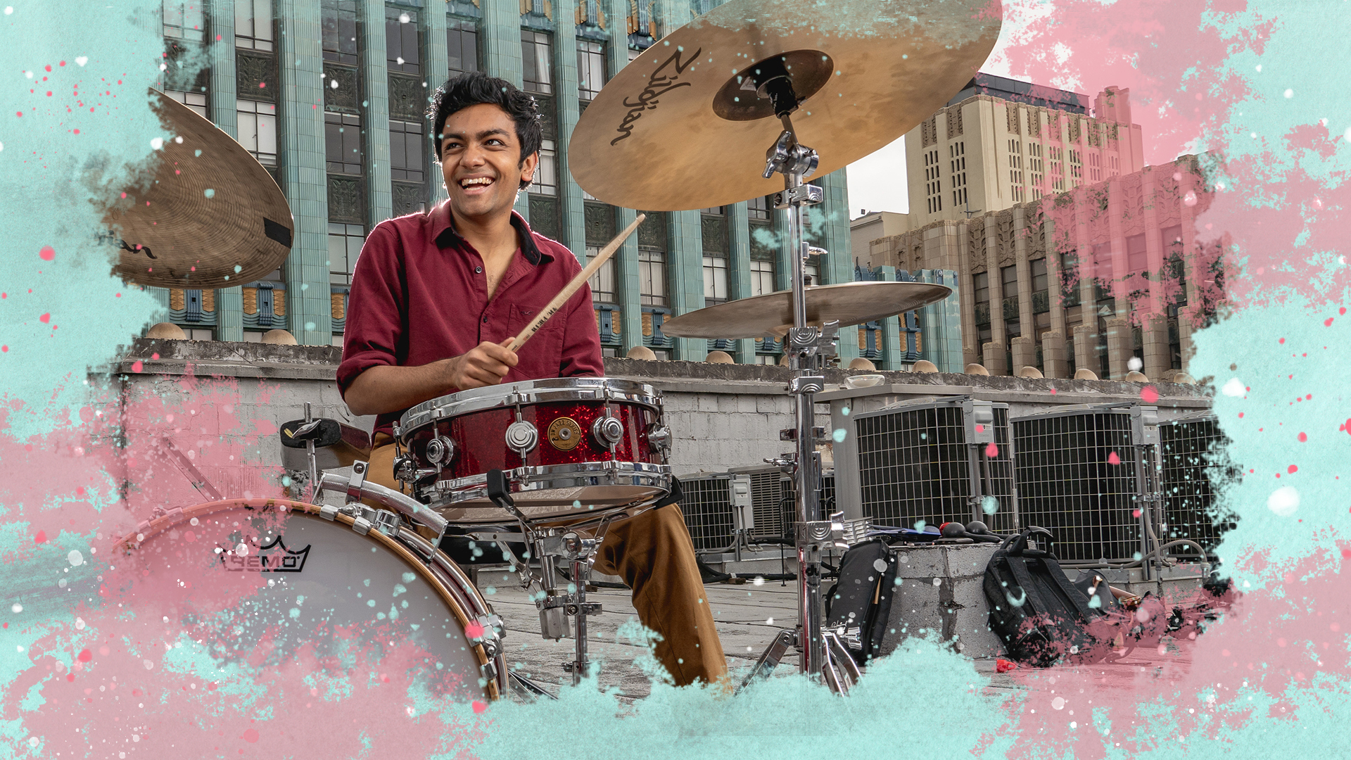Image of drummer on downtown rooftop, surrounded by an illustration of splashy colors