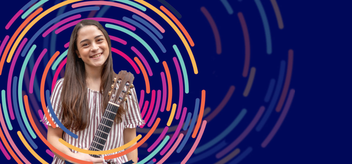 Photo of woman holding guitar with colorful graphics