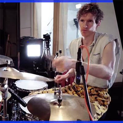 man playing drumset