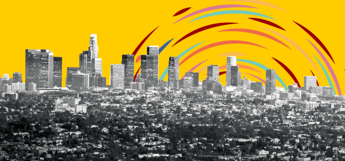 Black and white image of Los Angeles skyline with colorful graphics in the sky