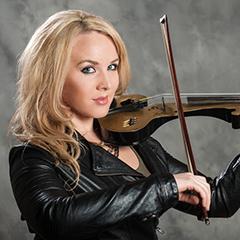 Ginny Luke in leather jacket holding violin