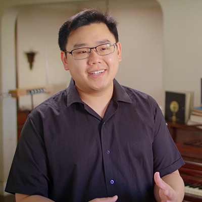 Jonathan Ong in his home speaking to camera