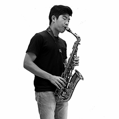 black and white picture of Simon Hwang playing saxophone