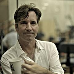 Roger Neill holding a coffee mug