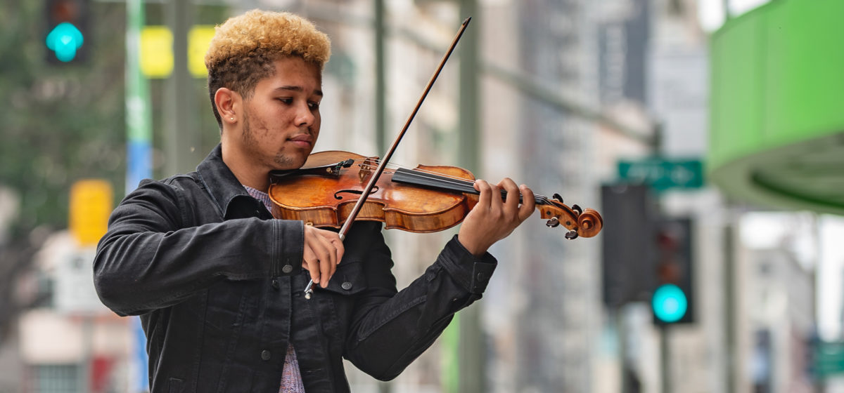 A violinist plays in downtown Los Angeles