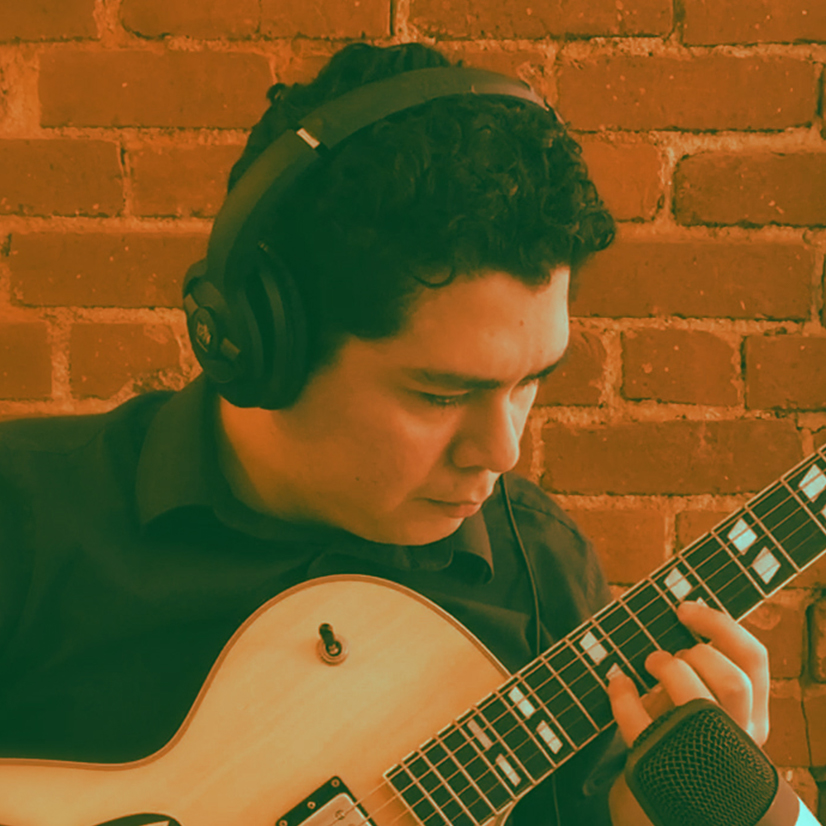 Guitarist playing with headphones on