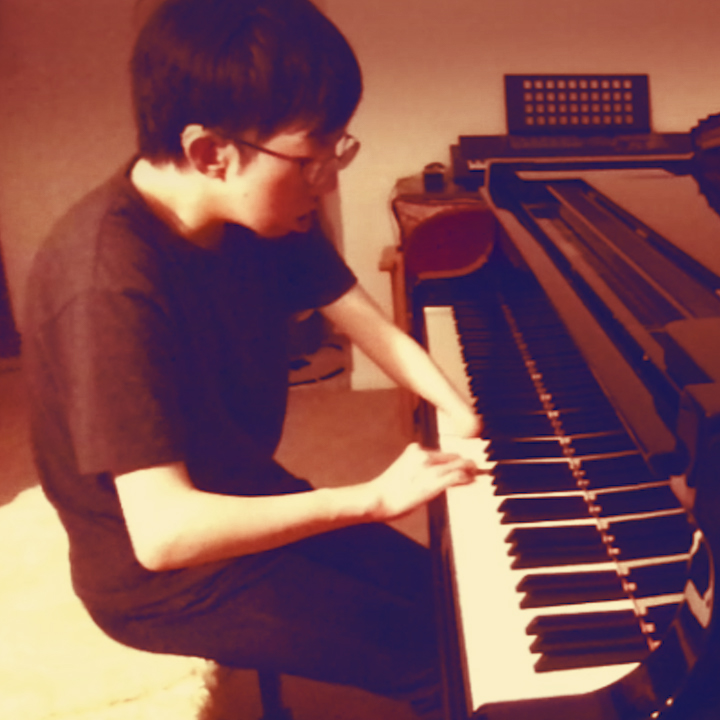 pianist sitting at piano