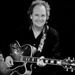Black and white picture of Lee Ritenour