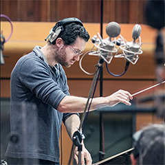 Austin Wintory conducting a recording session