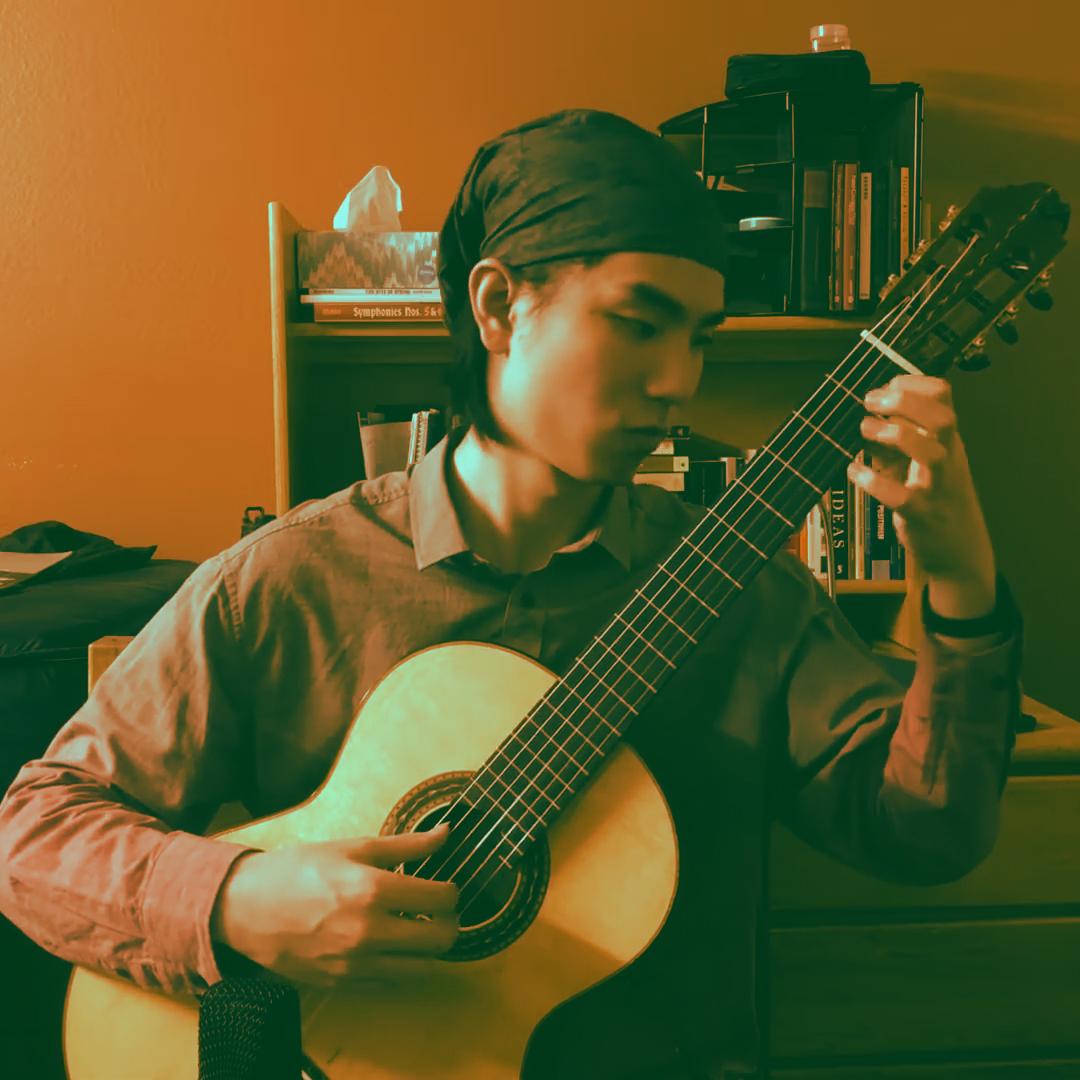 classical guitarist playing guitar