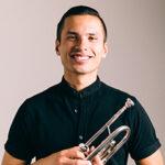 Chris O'Brien holding a trumpet