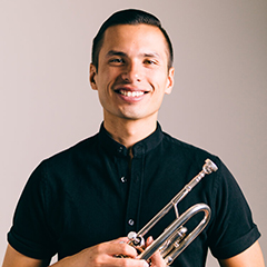 Chris O'Brien holding a trumpet