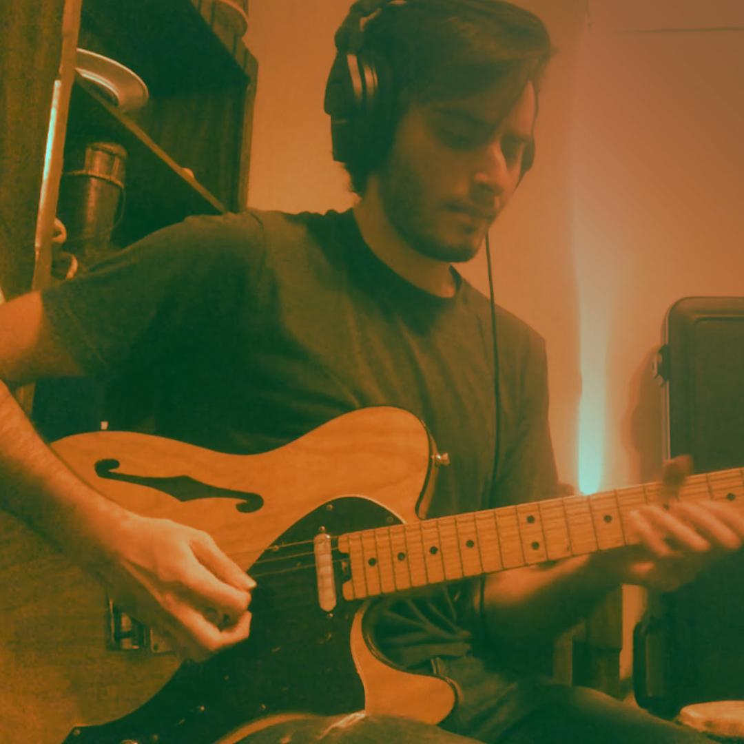 a guitarist wearing headphones