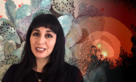 Leaha Maria Villarreal pictured in front of video art