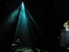 Nina C. Young on stage with dramatic lighting