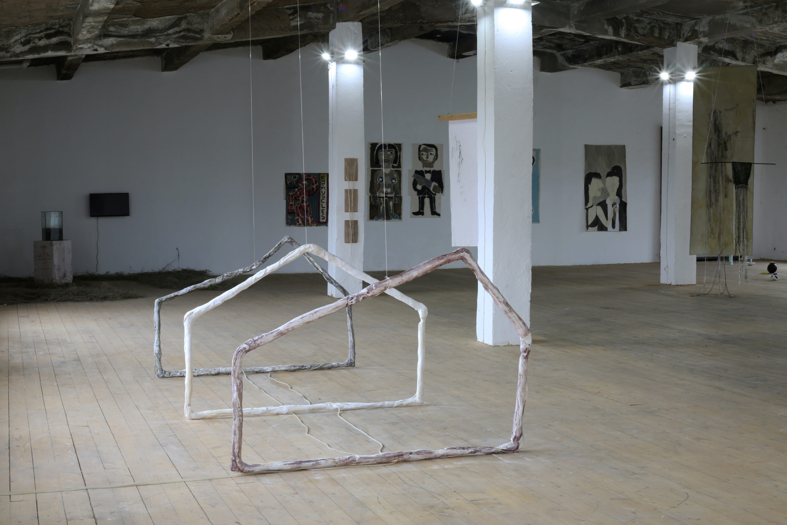 Art gallery displaying paintings and modern sculpture
