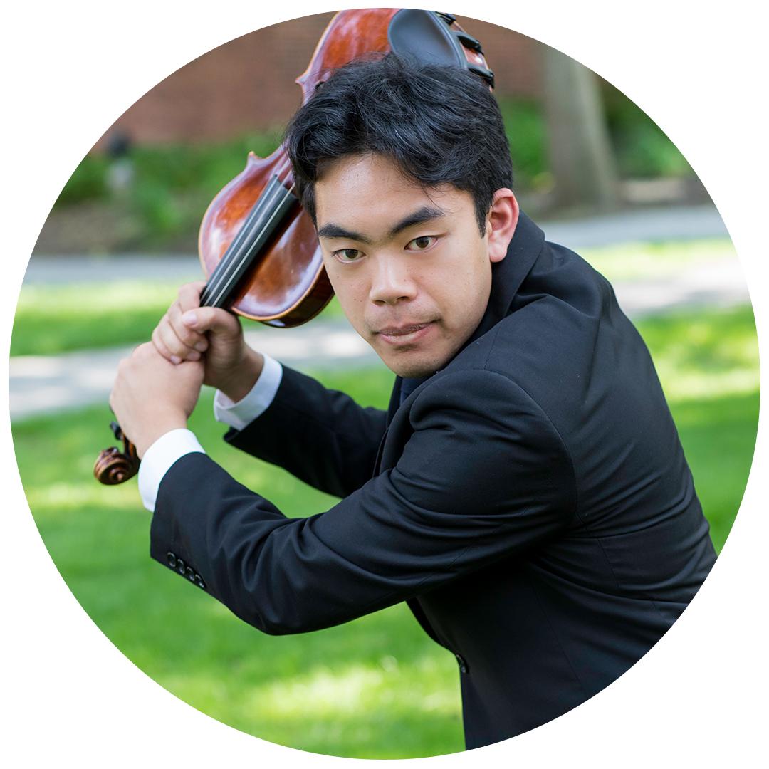 Portrait of Bradley Bascon holding a violin
