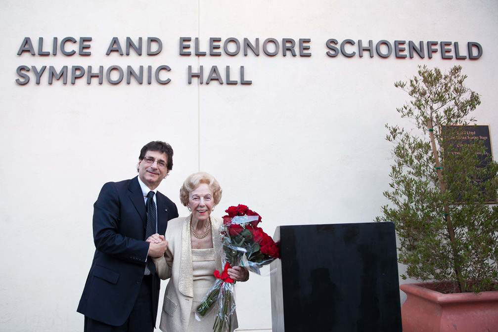 USC Thornton School of Music Dean Robert Cutietta stands with Alice Schoenfeld outside the newly constructed Alice and Eleonore Schoenfeld Symphonic Hall in 2013.